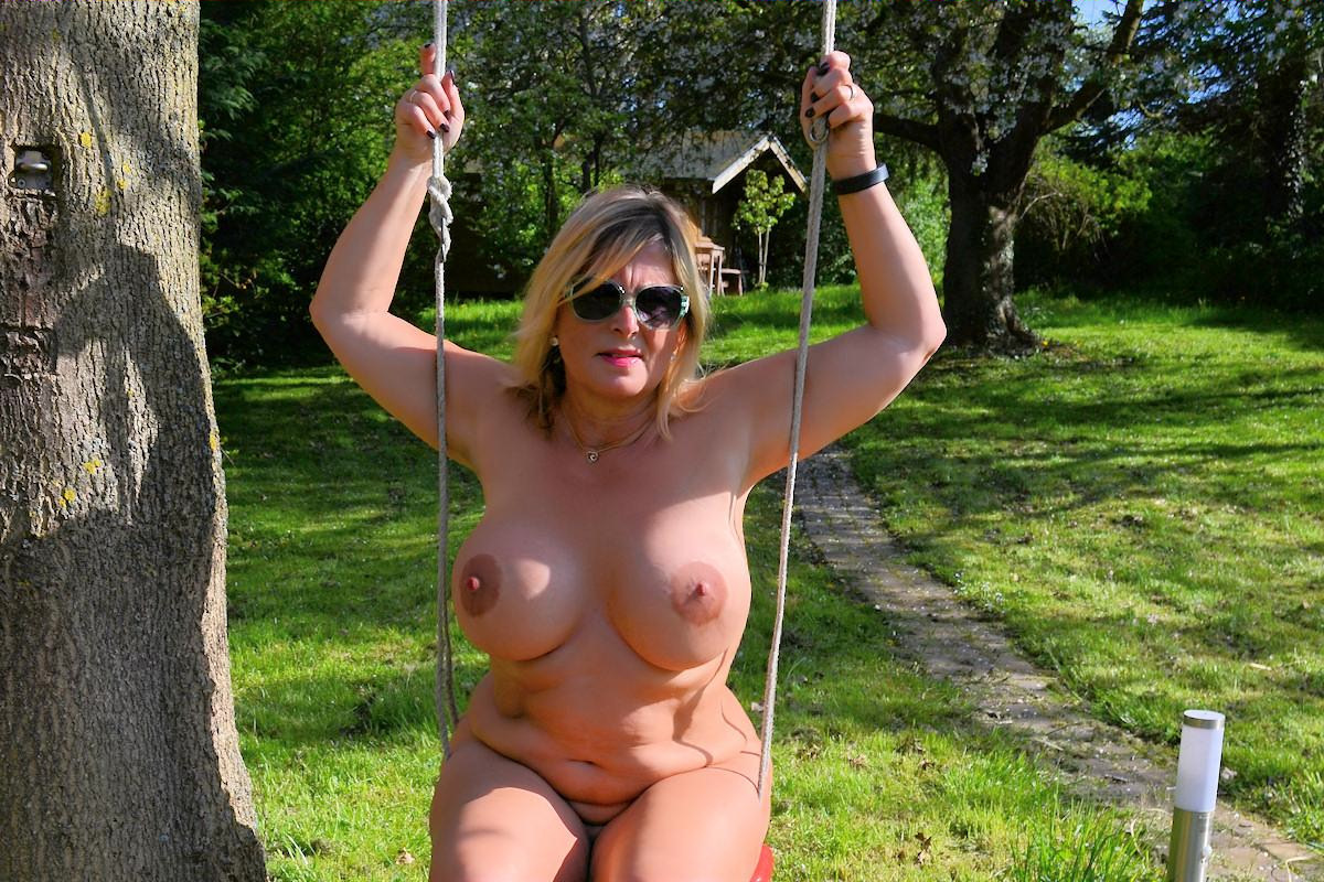 Nude women swinging