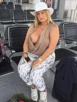 flashing her boobs at the airport